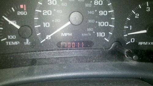 Odometer shows 110,011 miles, a palindrome.