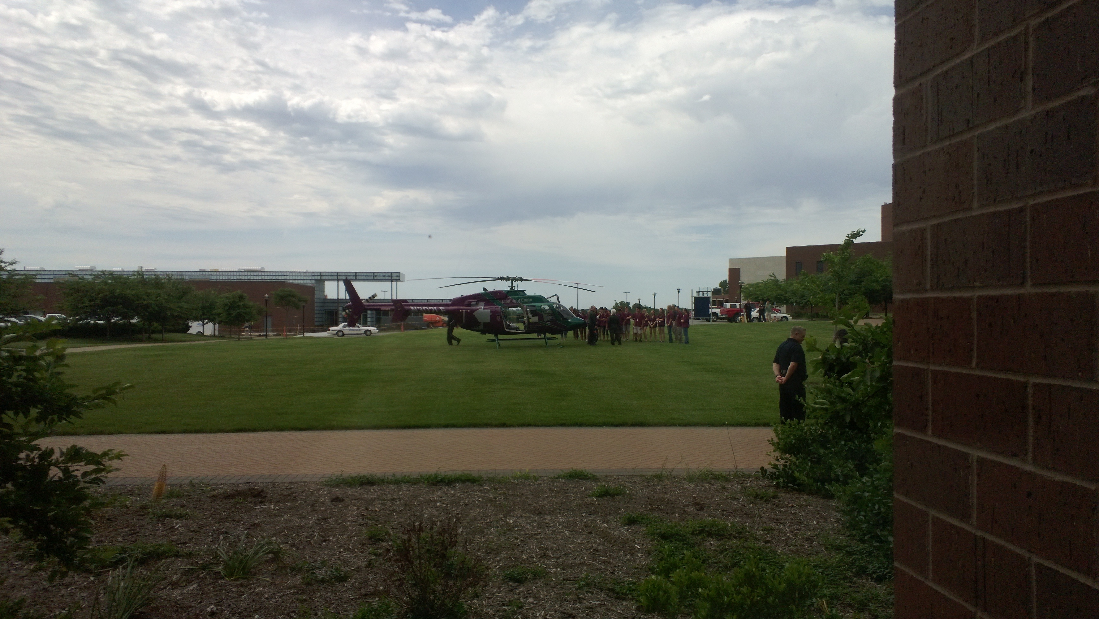 LifeFlight Eagle helicopter lands on the grassy area to the south of the Regnier Center as part of the training offered by the college's Men in Nurses Training program